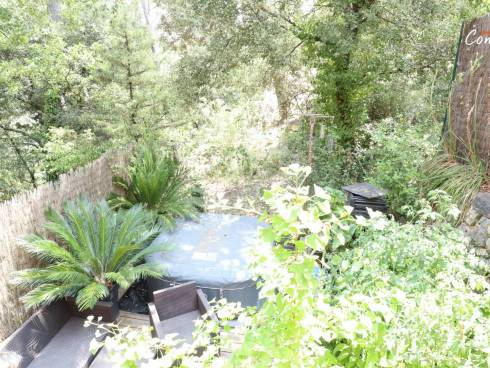 SOUS COMPROMIS - Maison mitoyenne avec jardinet et terrasses